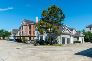 One Bedroom Apartments for Rent in Conroe, TX - Building with Attached Garages & Covered Parkng
