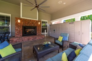 One Bedroom Apartments for Rent in Conroe, TX - Covered Outdoor Seating Area with Fireplace & Package Hub