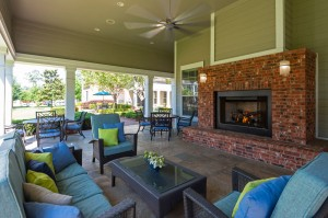 One Bedroom Apartments for Rent in Conroe, TX - Covered Outdoor Seating Area with lit Fireplace