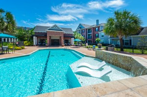 Three Bedroom Apartments for Rent in Conroe, TX -Pool & Patio Area with Clubhouse View (3)