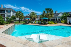Three Bedroom Apartments for Rent in Conroe, TX -Pool & Tanning Shelf with Community View