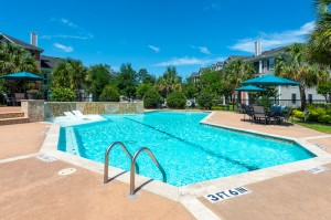 Three Bedroom Apartments for Rent in Conroe, TX -Pool with Tanning Shelf & Patio Area