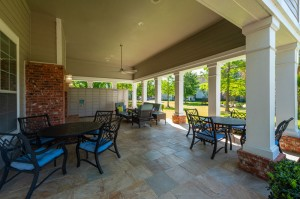 One Bedroom Apartments for Rent in Conroe, TX - Covered Outdoor Seating Area  & Package Hub