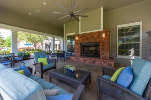 One Bedroom Apartments for Rent in Conroe, TX - Covered Outdoor Seating Area with Fireplace