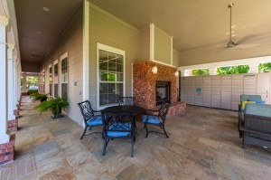 One Bedroom Apartments for Rent in Conroe, TX - Covered Outdoor Seating Area with Fireplace & Package Hub (2)