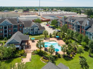 Three Bedroom Apartments for Rent in Conroe, TX -Aerial View of Community, Pool & Surrounding Area