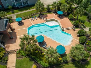 Three Bedroom Apartments for Rent in Conroe, TX -Aerial View of  Pool & Patio Area