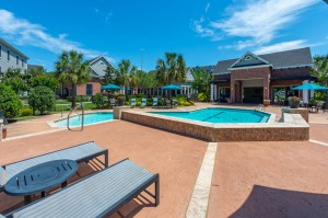 Three Bedroom Apartments for Rent in Conroe, TX -Pool & Patio Area with Clubhouse View