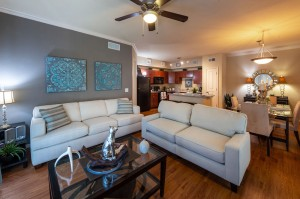 Three Bedroom Apartments for Rent in Conroe, TX - Model Living Room, Dining Room & Kitchen